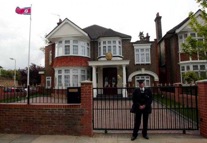 A policeman stands guard outside the newly-opened North Korean Embassy in west London, Britain April 30, 2003. REUTERS/Stephen Hird/File Photo